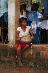 Child selling bread outside a medical clinic being given in a school in Bluefields, Nicaragua.  I was part of the medica