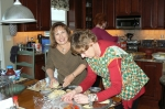 Robin Buzzelli Carpenter and Carolyn Trout Petteway help prepare the food for the event.